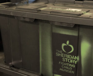A Container of Food Headed for The Sheridan Story Food Shelf