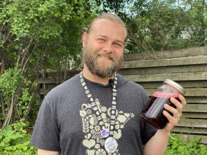 Sampson Holding Jar of DIY Sports Drink Functional Beverage