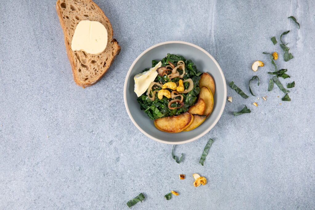 Image for Warm Kale Salad with Apples and Curried Cashews