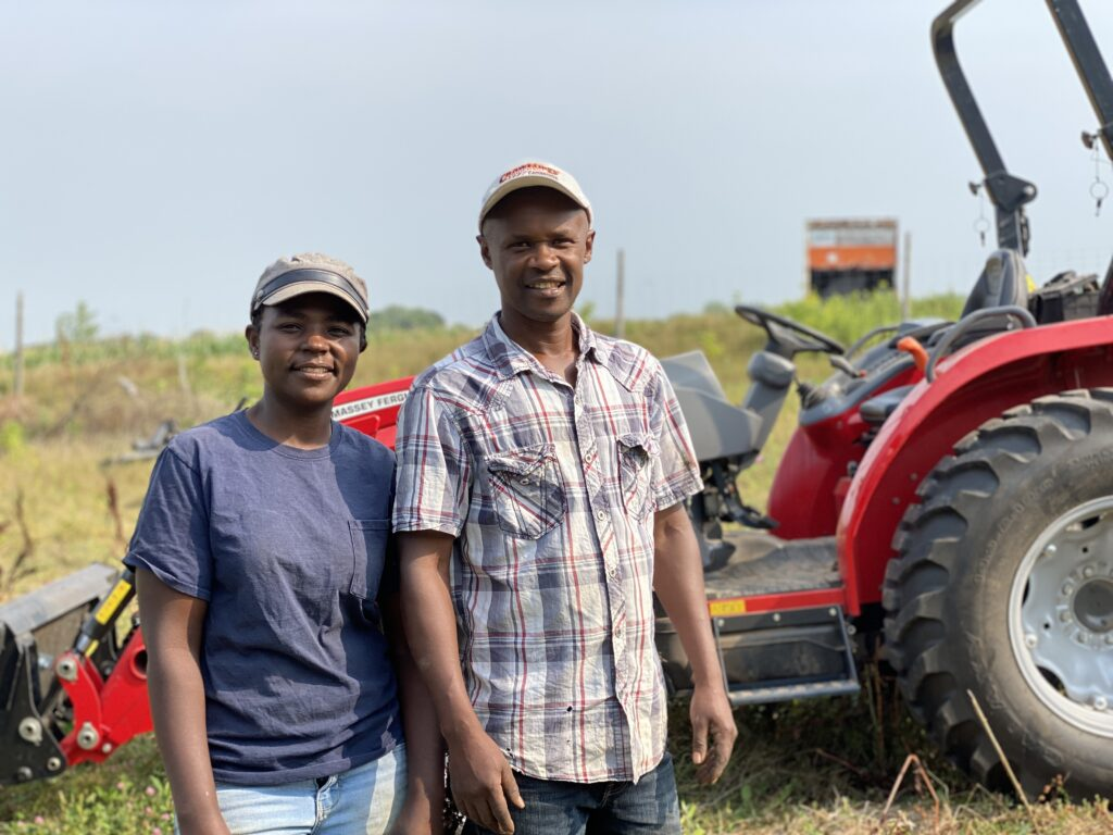 Lonah and Moses Stand by New Tractor
