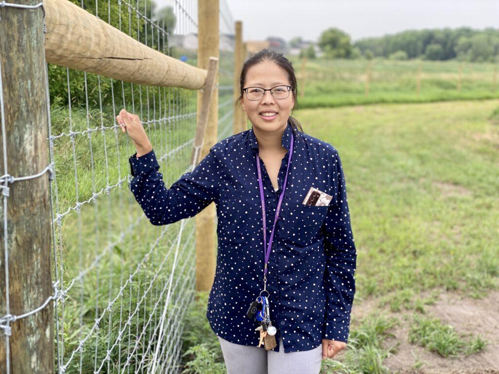 Mhonpaj Stands Alongside the New Fence