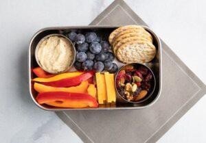 Bento Box with Veggies, Crackers, Hummus, Fruit